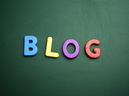 BLOG: blog concept in colorful letters isolated on blank blackboard