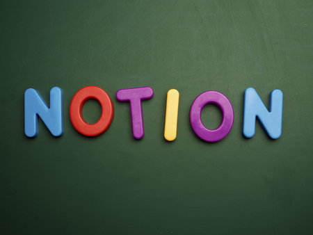 notion: notion concept in colorful letters isolated on blank blackboard