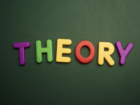 theory: theory concept in colorful letters isolated on blank blackboard Stock Photo
