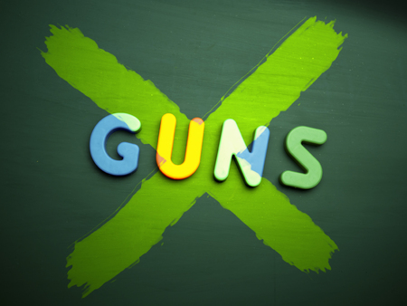 gun control: gun control concept in colorful letters isolated on blank blackboard