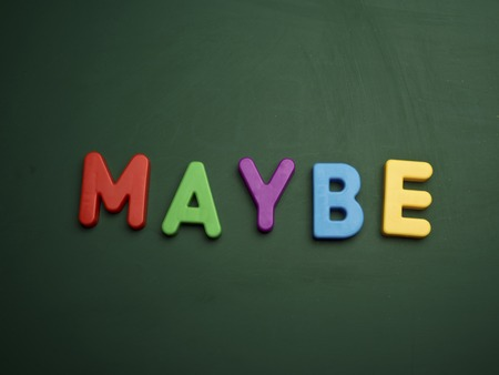 möglicherweise: maybe concept in colorful letters isolated on blank blackboard
