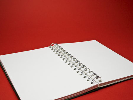 sketchbook: red background with a white sketchbook Stock Photo