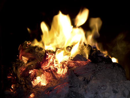burning money: The tradition of burning paper gold, paper money believed the Chinese for ancestor worship ceremonies. Stock Photo
