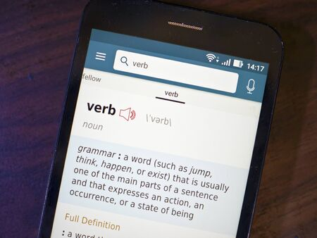 verb: Mobile phone with verb text on screen.