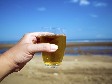 glass of tea at summer beach