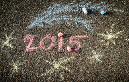 chalks: 2015 handwriten inscription on the pavement by chalks