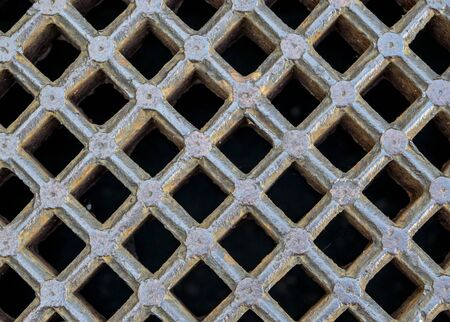 sewer: iron gray sewer grate as a background