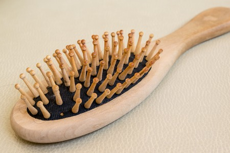 hairbrush: Wooden hairbrush with long hair on it Stock Photo