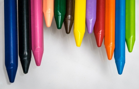 vax: colorfull pencils crayons wax set on gray background Stock Photo