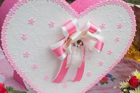 heart shaped gift box over photo