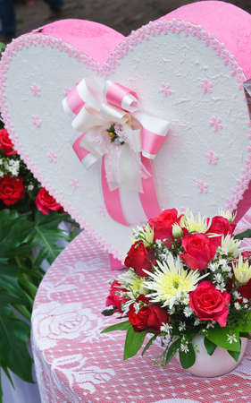 heart shaped gift box over photo