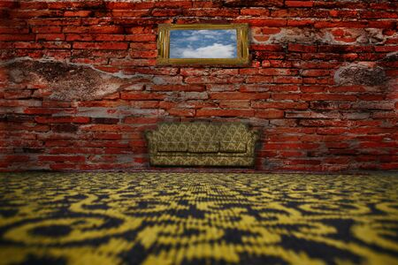 Sofa, rug on the floor in front of a brick wall.  photo