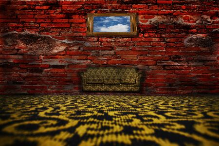Sofa, rug on the floor in front of a brick wall.  Stock Photo - 9913912