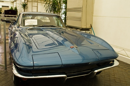 classical mechanics: BANGKOK - JUNE 25 : Chevrolet Corvette Sting-Ray, Vintage cars on display in Future park shopping center to celebrate the 35th vintage car event on June 25, 2011 in Bangkok, Thailand.