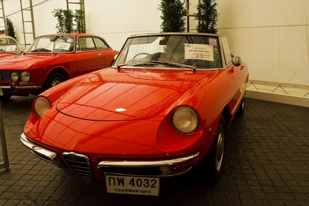classical mechanics: BANGKOK - JUNE 25 : Alfa Romeo Spider Junior, Vintage cars on display in Future park shopping center to celebrate the 35th vintage car event on June 25, 2011 in Bangkok, Thailand.