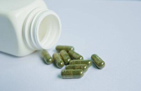 pot of capsule pills photo