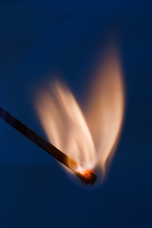 wooden matchstick igniting photo