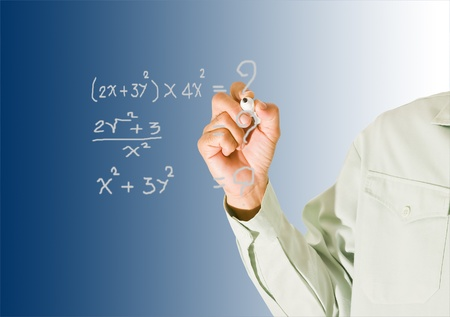 Teacher pointing at board Stock Photo