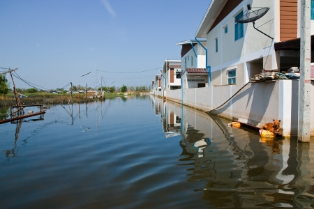 Bangkok, Thailand - November 16: The house that was flooded during the construction of 16 November 2011 at Pathum Thani. Bangkok, which is the worst flood in the history of Thailand.