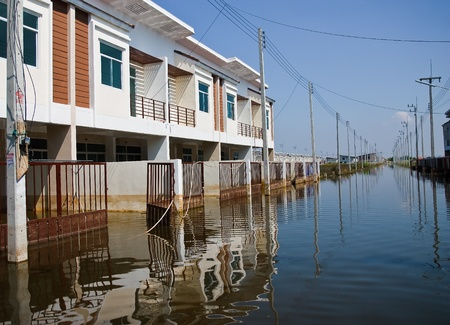 Bangkok, Thailand - November 16: The house that was flooded during the construction of 16 November 2011 at Pathum Thani. Bangkok, which is the worst flood in the history of Thailand. Stock Photo - 11286812