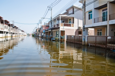 Bangkok, Thailand - November 16: The house that was flooded during the construction of 16 November 2011 at Pathum Thani. Bangkok, which is the worst flood in the history of Thailand. photo
