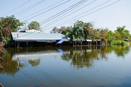Bangkok, Thailand - November 16: The house is flooded canal at November 16, 2011 at Pathum Thani. Bangkok, which is the worst flood in the history of Thailand.