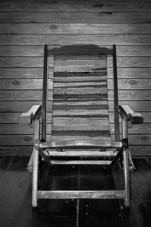Rocking chairs on the wooden floor.  photo
