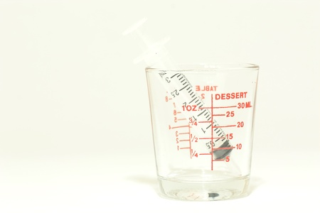 Glass measuring cup isolated on white background photo