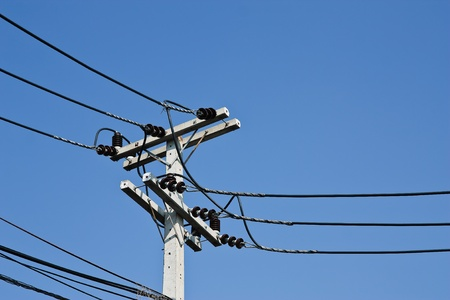 electricity post with blue sky  photo