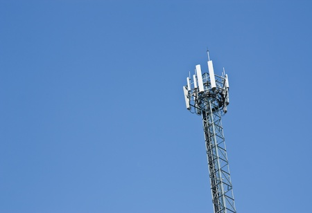 parabola: Modern cell and antenna with flat parabola on blue sky
