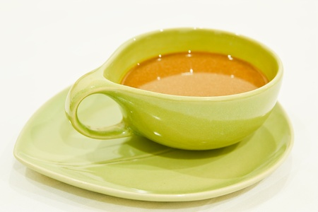 crema: Cup of coffee.