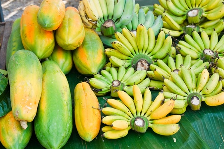 Papaya and bananas in the market. photo