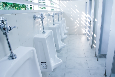 modern restroom inter with urinal row Stock Photo - 12235608