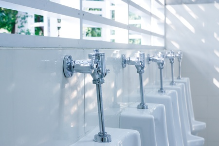 modern restroom interior with urinal row photo
