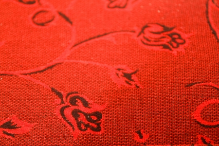 Pattern on a red cloth  photo