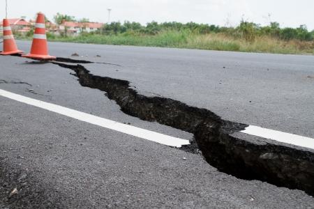 The road has cracks  Stock Photo