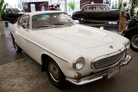 classical mechanics: BANGKOK - JUNE 24   Volvo P1800, Vintage cars on display in Future park shopping center to celebrate the 36Th vintage car event on June 24, 2012 in Bangkok, Thailand