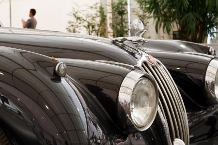 classical mechanics: BANGKOK - JUNE 24 : Jaguar XK140, Vintage cars on display in Future park shopping center to celebrate the 36Th vintage car event on June 24, 2012 in Bangkok, Thailand.