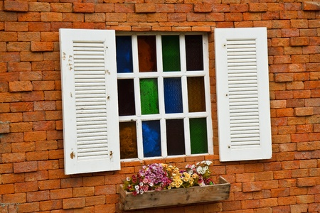 Window with flower pots.