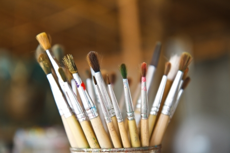 Old paint brushes in cans Stock Photo - 19943225