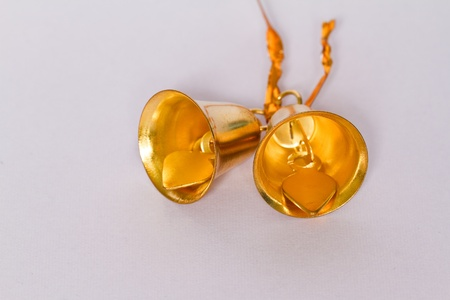 Gold bells on a white background  photo