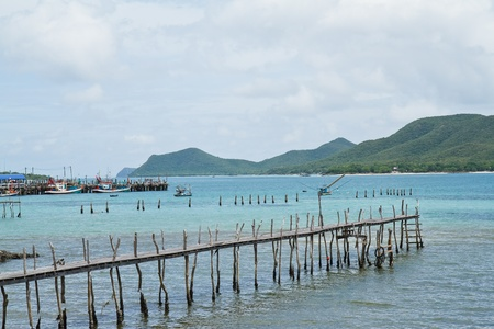 wooden bridge to the sea,Thailand photo