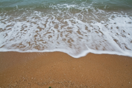 Sea wave over sand photo