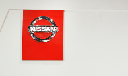 automaker: BANGKOK - DECEMBER 1  The emblem Nissan on White background, December 1, 2013 inBangkok  Nissan is a Japanese multinational automaker headquartered in Nishi-ku, Yokohama, Japan