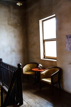 aciculum: Chair in a dark room