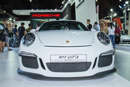 30 s: BANGKOK - March 30  Porsche Carrera S car on display at The 35th Bangkok International Motor Show on March 30, 2014 in Bangkok, Thailand