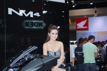 BANGKOK - MARCH 30 : Unidentified model with Honda on display at The 35th Bangkok International Motor Show on March 30, 2014 in Bangkok, Thailand
