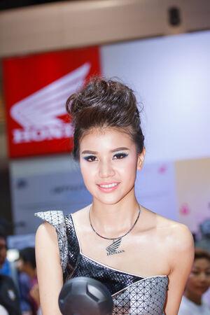 BANGKOK - MARCH 30   Unidentified model with Honda on display at The 35th Bangkok International Motor Show on March 30, 2014 in Bangkok, Thailand