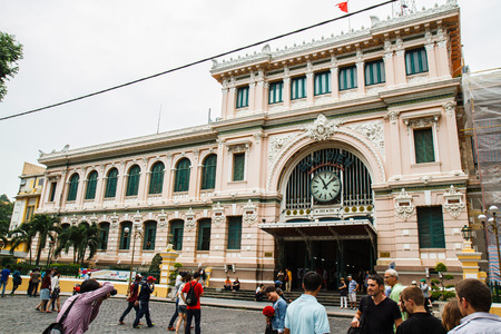 Ho Chi Minh, Vietnam - 12 October 2014: Customers and visitors to the post office. It was built by the French in the 1880s and is a popular tourist attraction in the city of Ho Chi Minh.