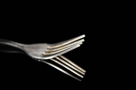 shiny black: fork isolated on a black background